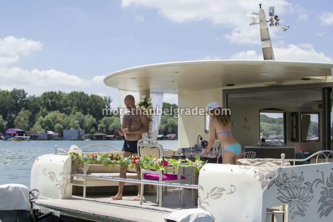 Guys enjoying bachelor party on the boat in Belgrade