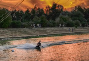 Sunset on Ada lake wakeboarding